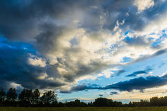 Sunset Landscape with Clouds. And trees stock photography