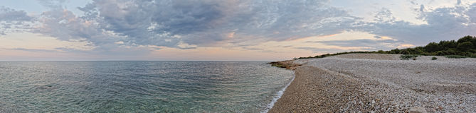 Sunset landscape with coast of the sea. Panorama. Stock Images