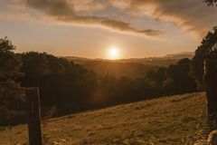 Sunset landscape in countryside rural area with forest and vegetation stock photography