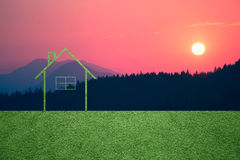 Sunset landscape with eco home background Royalty Free Stock Photography