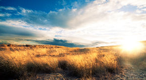 Sunset landscape.Fields and hill Royalty Free Stock Photos