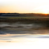 Sunset landscape with fog. Fog near water in sunset - landscape with white top and bottom edge Stock Photography