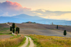 Sunset Landscape with ground road in countryside Stock Photos