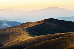 Sunset landscape in mountains Stock Photos