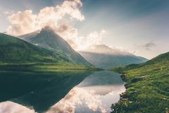 Sunset Landscape Mountains and Lake reflection with sky clouds Summer Travel Royalty Free Stock Image