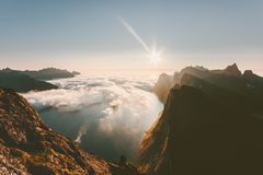 Sunset landscape mountains over fjord and clouds stock photos