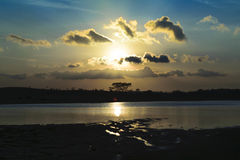 Sunset and landscape. Natural Sunset with landscape Silhouette Stock Photography