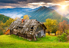 Sunset landscape with old rural house Stock Images