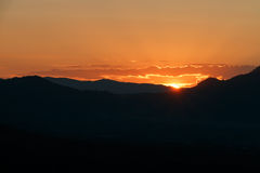 Sunset landscape orange sky and silhouette mountian Stock Photo