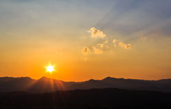 Sunset. Landscape of sunset over silhouette mountain Stock Photos