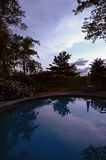 Sunset landscape reflected in pool Royalty Free Stock Image