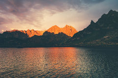 Sunset Landscape Rocky Mountains and Lake reflection Stock Images