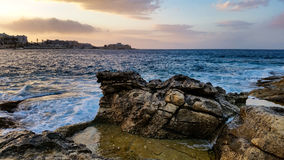 Sunset landscape from a rocky shore Stock Photo