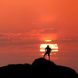 Sunset landscape with silhouette of a standing man. Travel backg Royalty Free Stock Photos