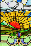 Sunset landscape in stained glass. Yellow sunset in stained glass window Stock Photo