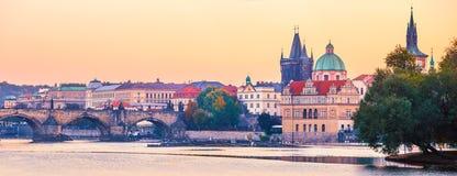 Sunset landscape view to Charles bridge on Vltava river in Prague Stock Photos