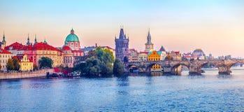 Sunset landscape view to Charles bridge on Vltava river in Prague Stock Images