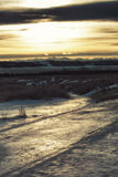 Icy Sunset. Sunset landscape with warm light reflected in the ice Royalty Free Stock Images