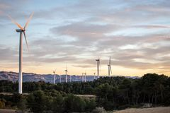 Sunset of landscape with windmills royalty free stock images