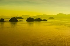 Sunset in the langkawi archipelago malaysia. Sunset in the Langkawi archipelago with its islets bathed by the Andaman Sea in the Strait of Malacca. malaysia royalty free stock photo