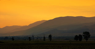 Sunset lanscape with mountains Stock Image