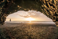 The sunset from a large cave in Iceland. This picture shows the sun setting from a large coastal cave in Iceland stock photography