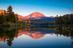Sunset at Lassen Peak with reflection on Manzanita Lake. Lassen Volcanic National Park, California royalty free stock photography