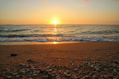 Sunset last light on sky line shell on beach. Sunset last light on sky line and shell on beach Stock Image