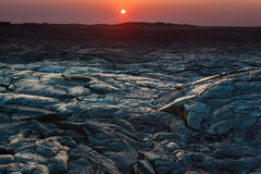 Sunset and  lava landscape Stock Photography