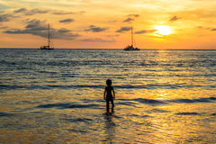 Sunset on the Layan beach, Phuket in Thailand Royalty Free Stock Photography
