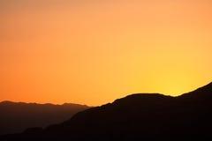 Sunset and layered mountains. Sun is setting above layered mountains in Wadi Rum desert, Jordan stock photos