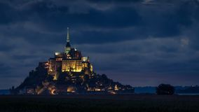 After sunset at Le Mont Saint Michelle in summer, blue hour stock photos