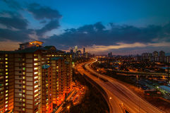 Sunset with leading line highway at kuala lumpur. This image taken from titwangsa lake stock photography