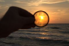 Sunset through lens. A view on sunset through camera lens on atlit beach great nature Royalty Free Stock Photos
