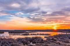 Sunset at Liberty Loop in late winter, part of the Wallkill River NWR, N. Sunset at Liberty Loop, part of the Wallkill River NWR, NJ, in late winter as the ice stock image