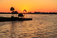 Sunset at Lido Beach. Beautiful sunset and the view of palm trees at Sarasota Bay Stock Photo