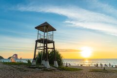 Sunset at lifeguard tower in Karon beach.
