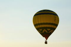Golden Sunset Liftoff of Hot Air Balloon Stock Images