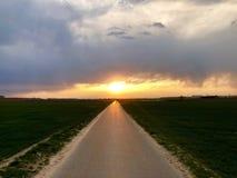 Sunset light above asphalt road stock photography