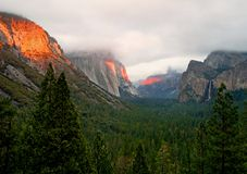 Sunset light across the mountains. In Yosemite Valley Stock Image