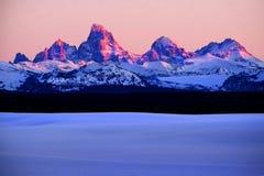 Sunset Light Alpen Glow on Tetons Teton Mountains royalty free stock image