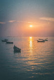 Sunset with light boat. Fishermen boats on sea when sunset lighting Stock Photos