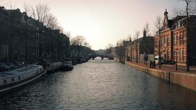 Sunset Light On Buildings By Canal stock video