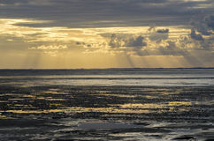 Sunset light through the clouds from the beach, Bay of Saint Mic Royalty Free Stock Photos