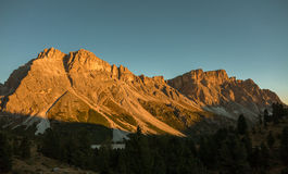 Sunset light on dolomites mountains. Beautiful Sunset light on dolomites mountains in Trentino, Italy Royalty Free Stock Photography