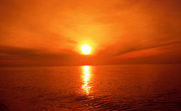 Sunset and light effects on the sea surface. Royalty Free Stock Images
