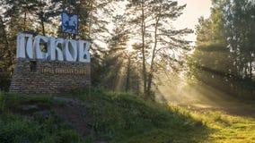 Sunset light in forest near Pskov city sign Stock Image