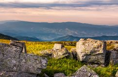 Sunset light on hills with stones. Beautiful mountainous landscape on a cloudy day Stock Image