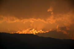 Sunset light from the mountain and cloud Royalty Free Stock Photos