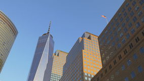 Sunset light new york city freedom tower buildings tops american flag 4k usa stock video
